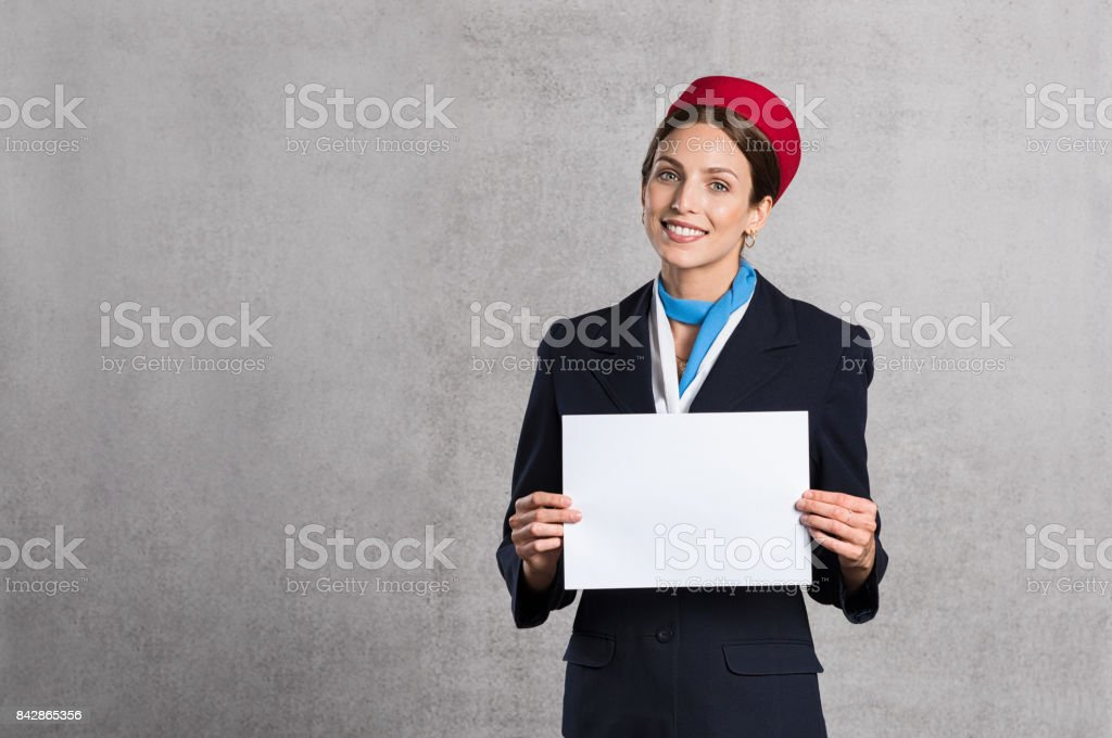 Flight assistant wishing Bon Voyage stock photo