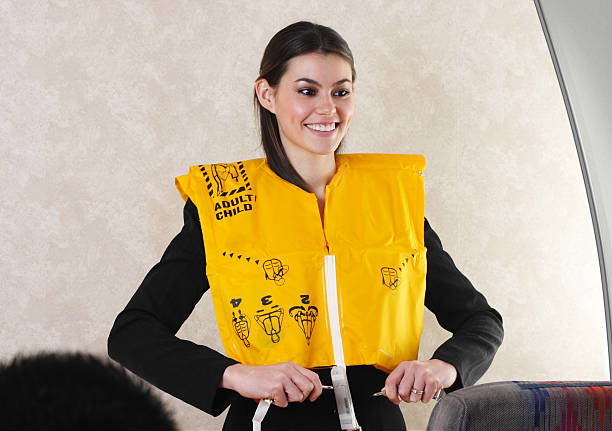 Flight Attendant And Life Vest stock photo