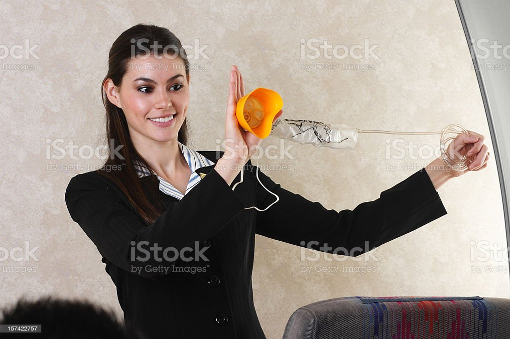 Flight Attendant And Oxygen Mask stock photo