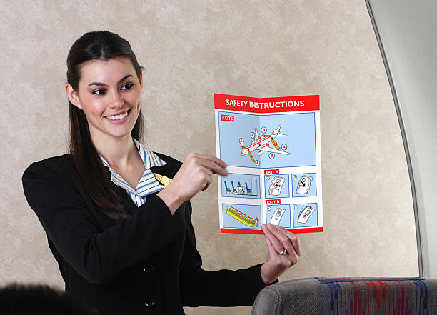 Flight Attendant And Safety Card stock photo