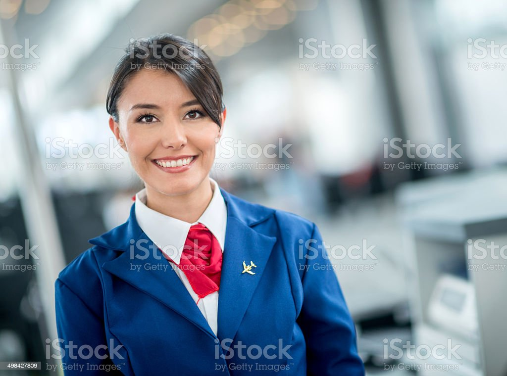 Flight attendant at the airport stock photo