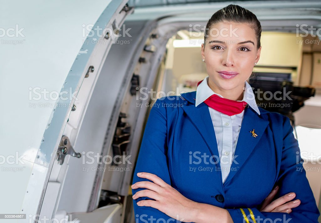 Flight attendant in the plane stock photo