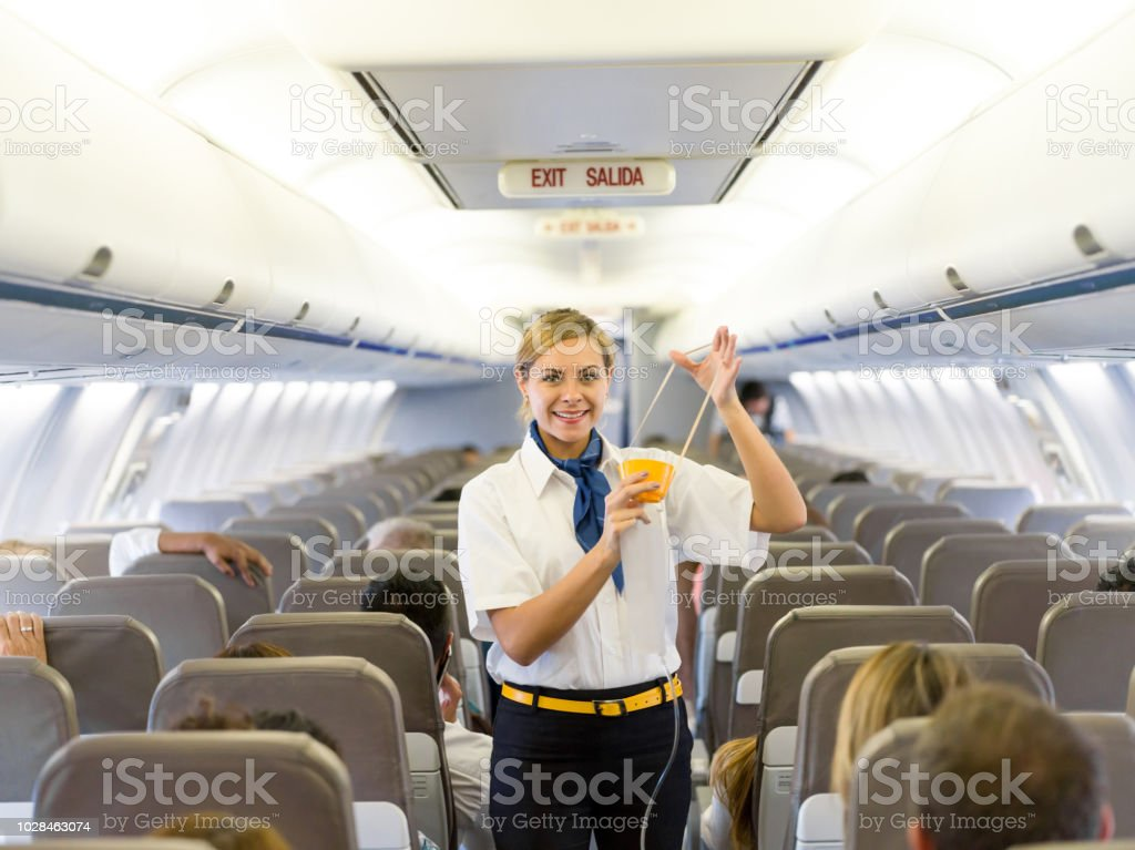 Flight attendant making an in-flight safety demonstration stock photo