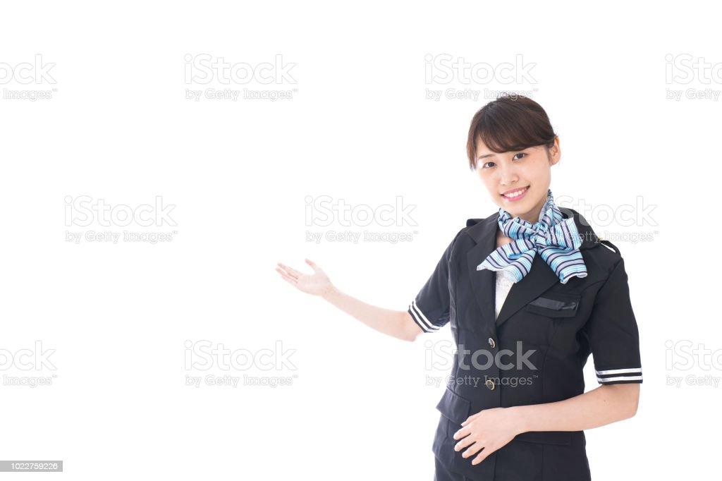 Flugbegleiterin zeigen, um – Foto