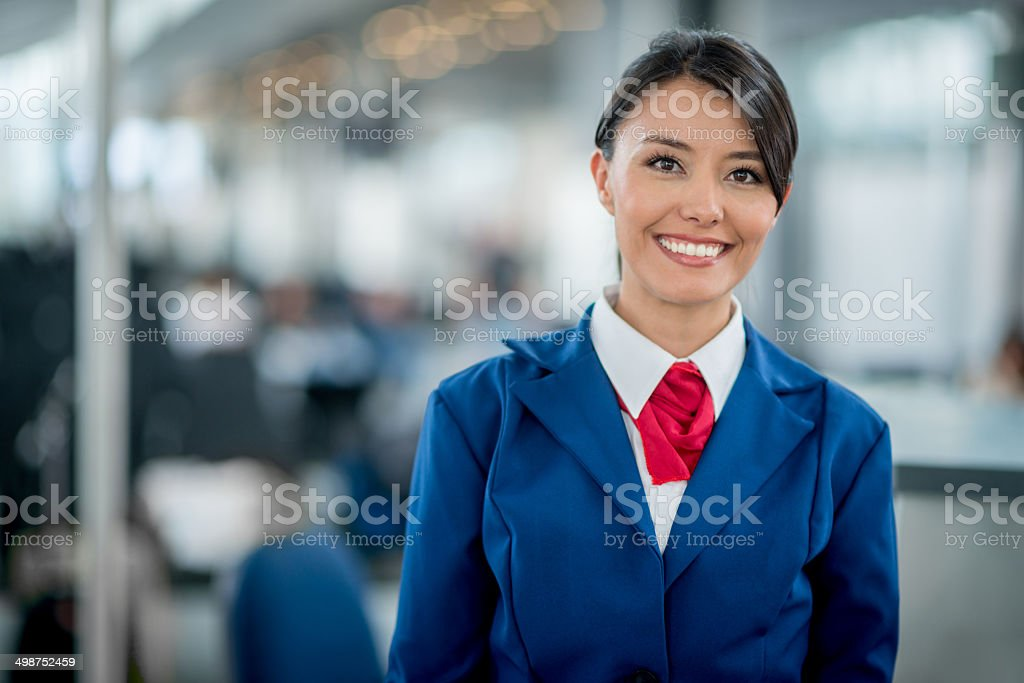 Flight attendant smiling stock photo