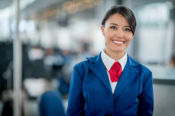 Flight attendant smiling Friendly flight attendant smiling at the airport cabin crew stock pictures, royalty-free photos & images