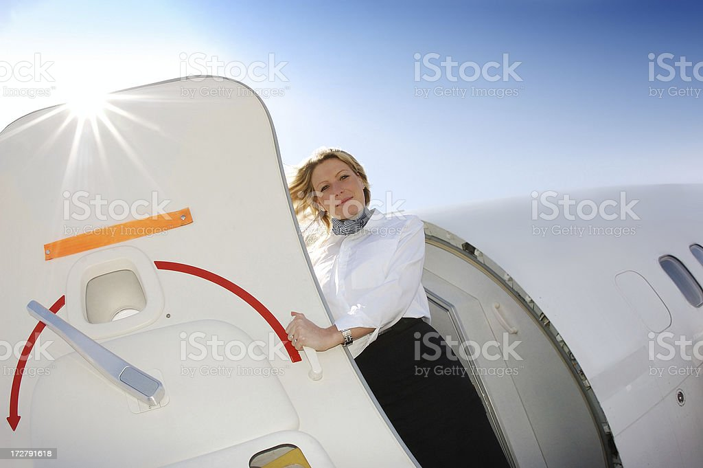 Flight attendant standing at the aircraft door royalty-free stock photo