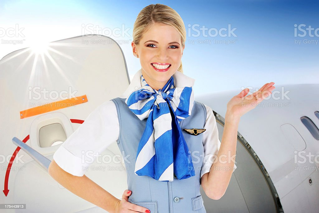 Flight attendant standing in the aircraft door royalty-free stock photo