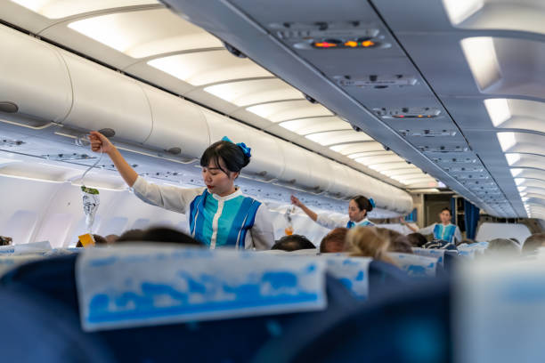 flight attendants demonstrate the proper use of oxygen masks before flight SUVANNABHUMI AIRPORT, BANGKOK, THAILAND - MARCH 23, 2019 : Flight attendants demonstrate the proper use of oxygen masks before flight oxygen mask stock pictures, royalty-free photos & images