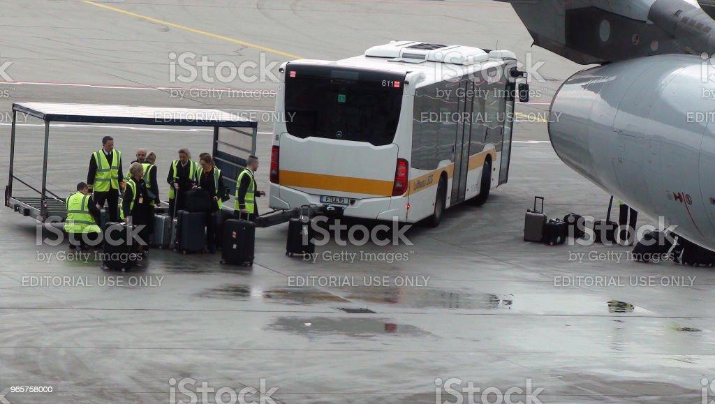 De weergave van de bedienden van de vlucht in Frankfurt International Airport In Duitsland. Europa - Royalty-free Aankomst Stockfoto