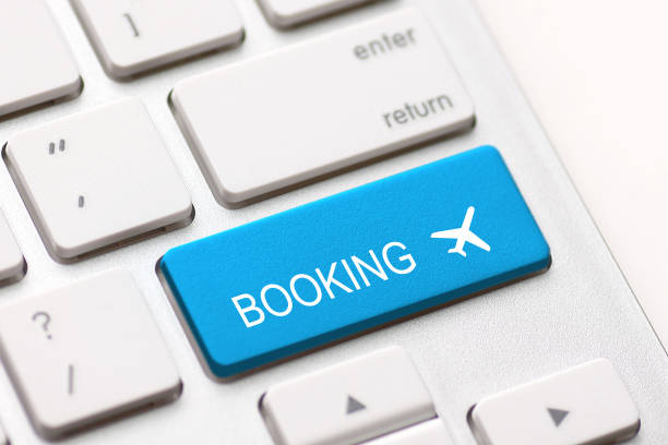 flight booking keyboard plane travel fly check buy - foto stock