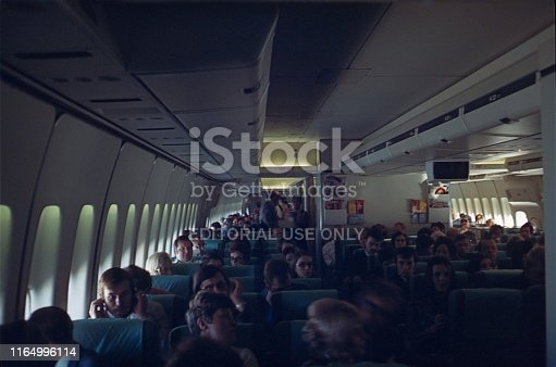 Dusseldorf, North Rhine Westphalia, Germany, 1979. Flight cabin of a Boeing 747 with passengers and flight crew.