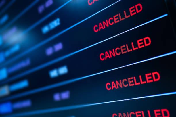 Flight cancellation airport lockdown stock photo