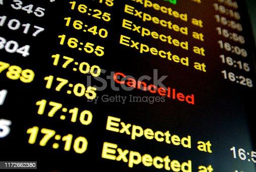 Flight cancelled illuminated on airport arrivals board