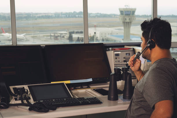 flight controller working in the flight control tower. stock photo