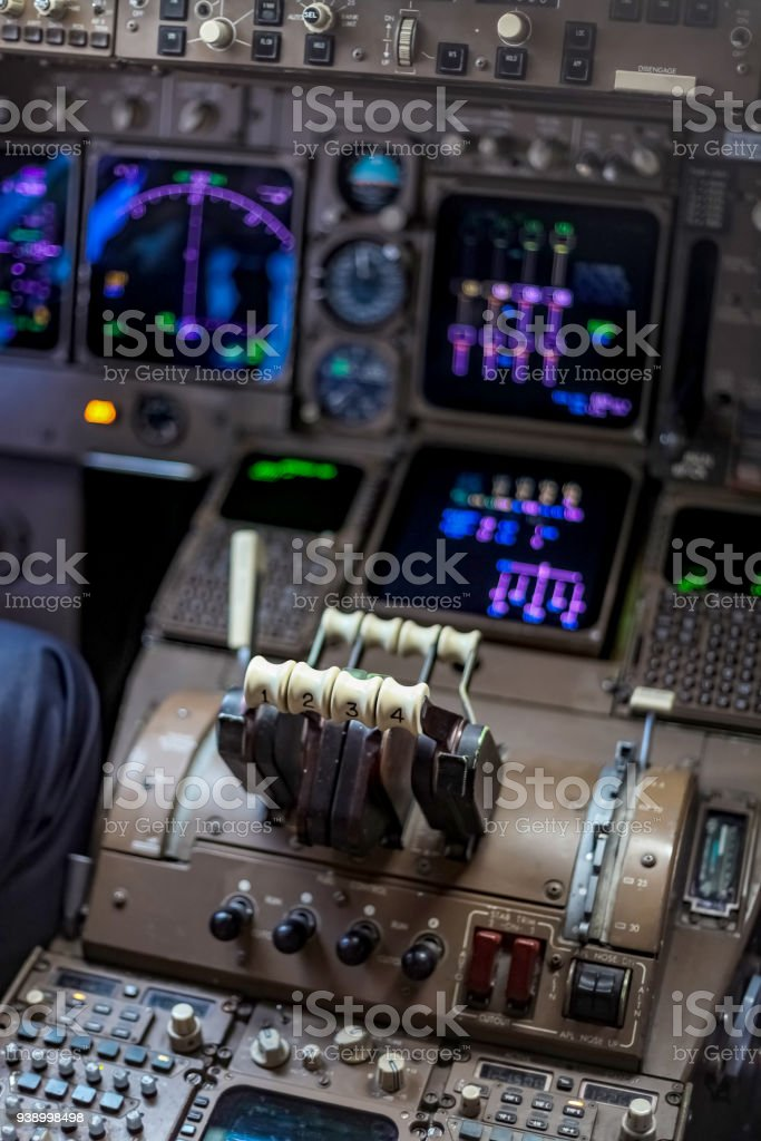 Flight controls in an airplane cockpit stock photo