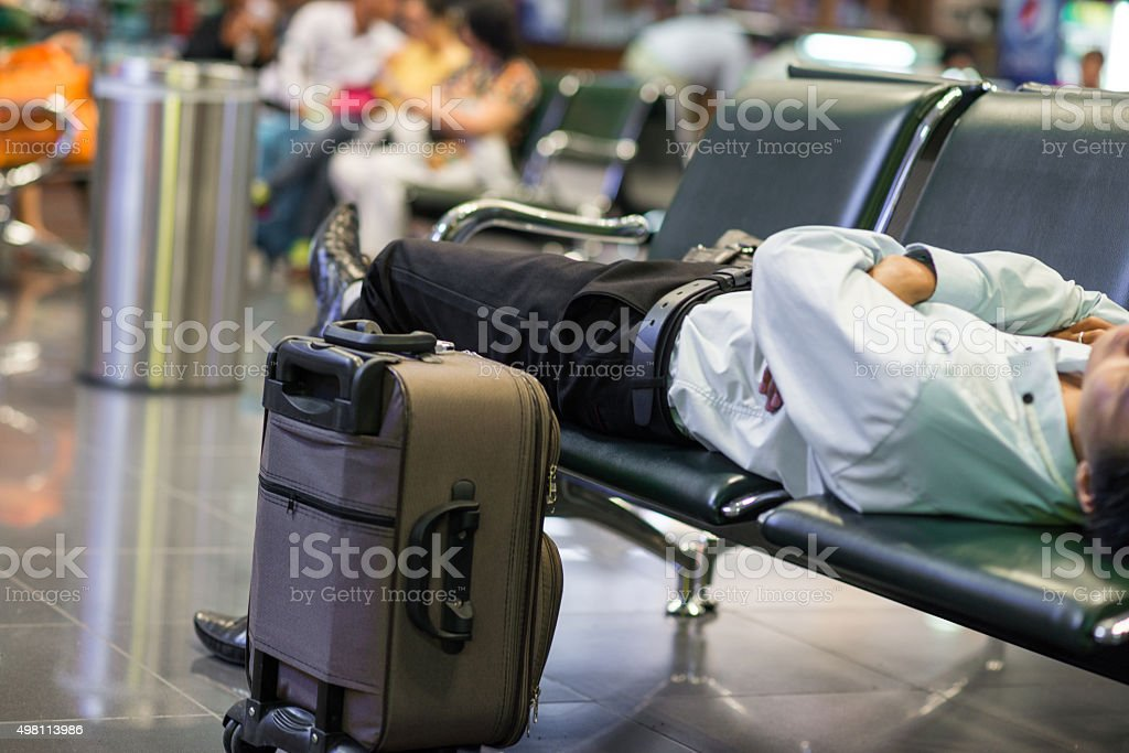 Flight delay makes people tired and exhausted after waiting long stock photo