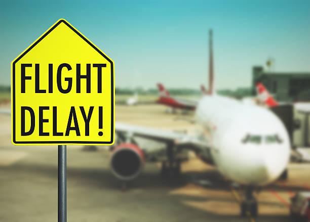 Flight delay street signe à l'aéroport - Photo