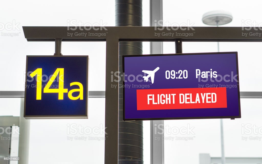 Flight delayed. Information on monitor at a gate in airport terminal. stock photo