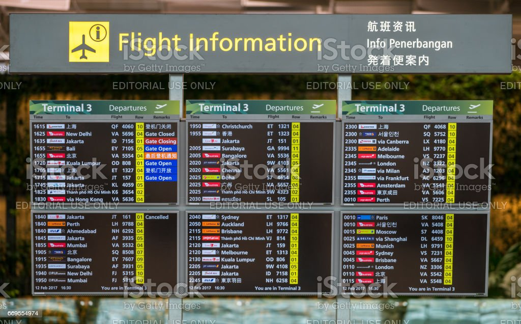 Flight information board in Changi airport in Singapore stock photo