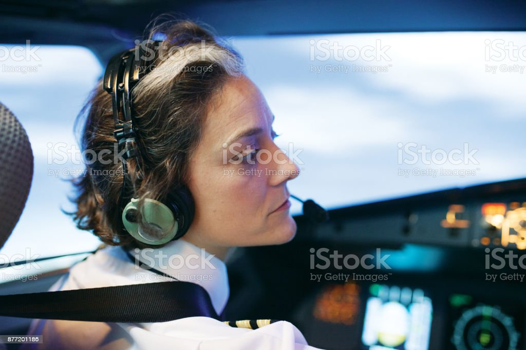 Flight Instructor Operating Aircraft Simulator stock photo