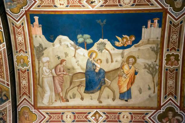 flucht nach ägypten von giotto in basilika von st.franziskus - giotto stock-fotos und bilder