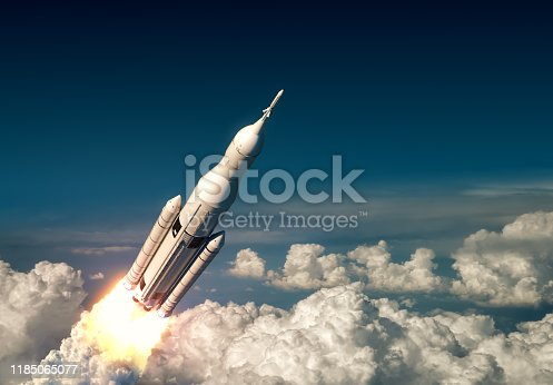 Flight Of Big Carrier Rocket Above The Clouds. 3D Illustration.