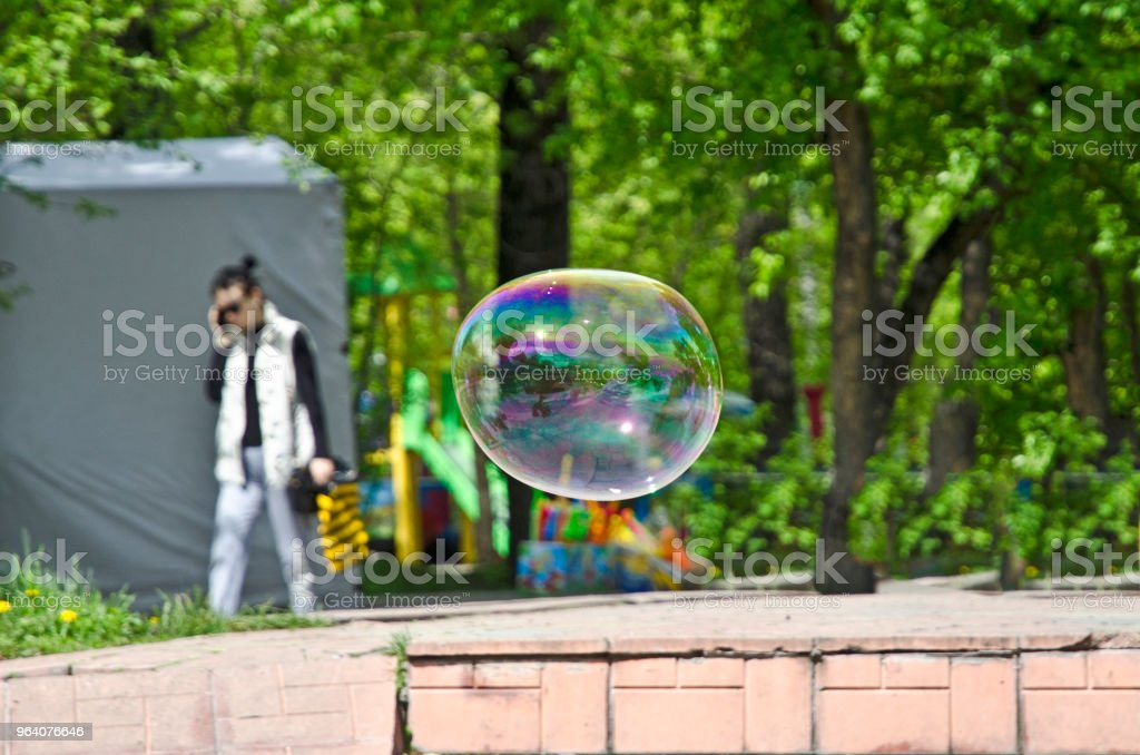Flight of soap bubble in the park. They are up in the air - Royalty-free Blowing Stock Photo
