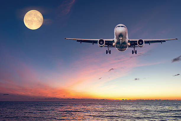 Flight of the plane above the ocean. stock photo