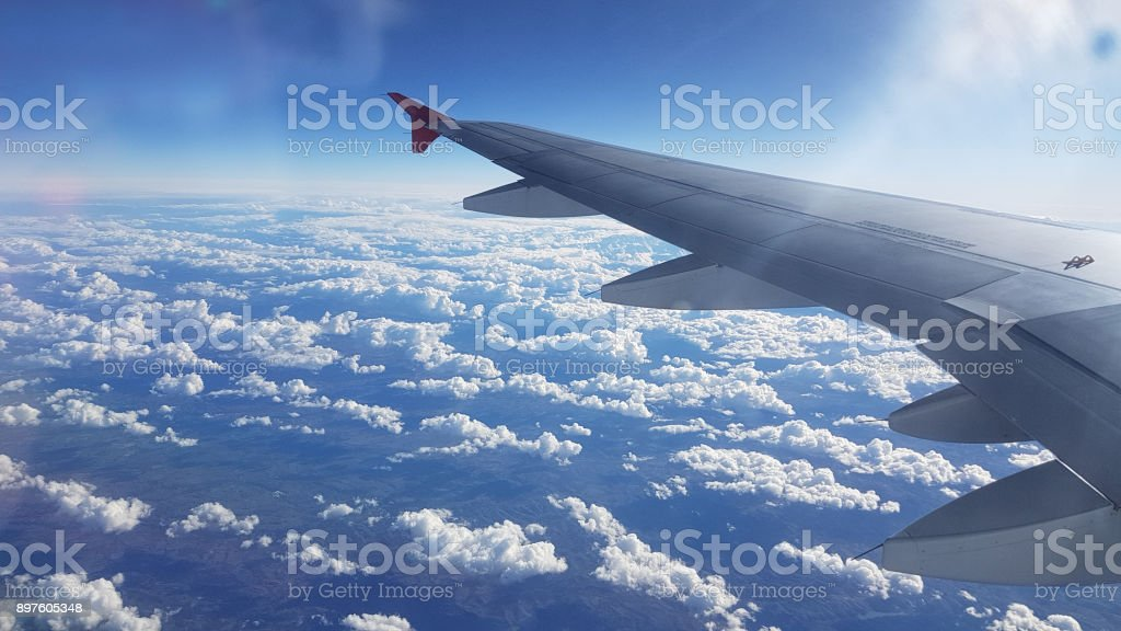Flight over cloud cover stock photo