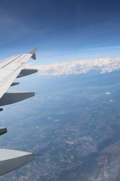 Flight over Italian lakes stock photo