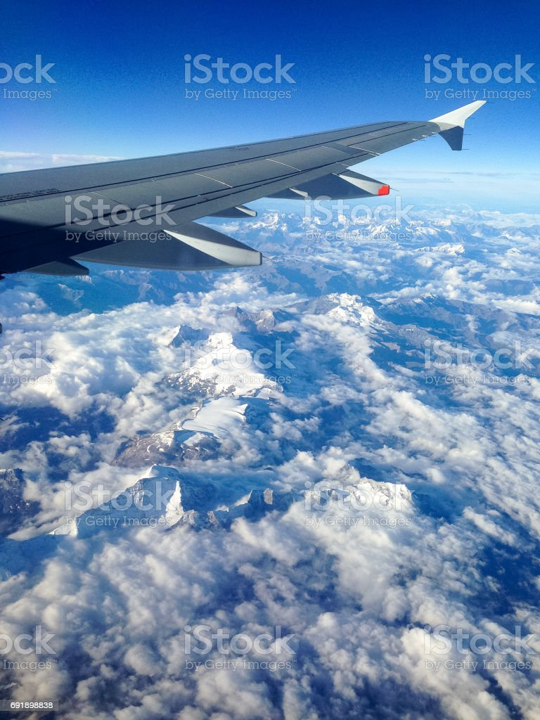 A flight over the Alps stock photo