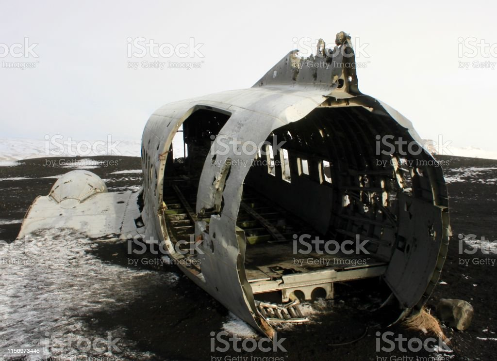 Flight Risk An abandoned United States Navy Douglas Super DC-3 plane lies on shore of Iceland's black sand of Sólheimasandur Beach. Abandoned Stock Photo