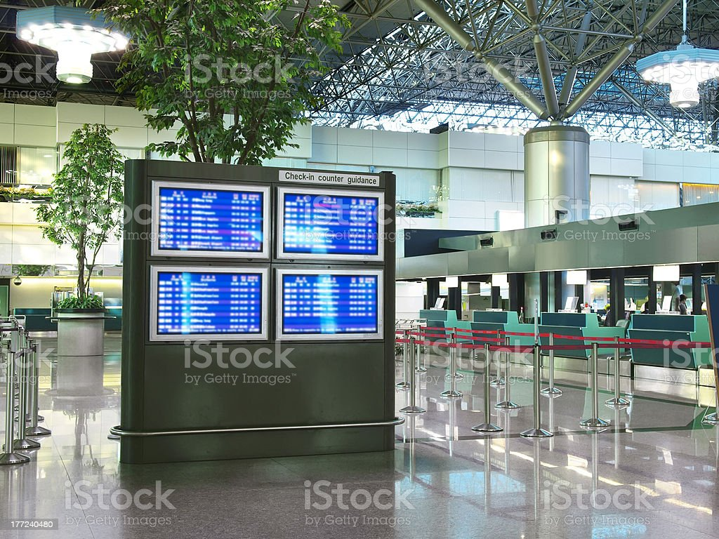 Flight schedule and check in counter stock photo