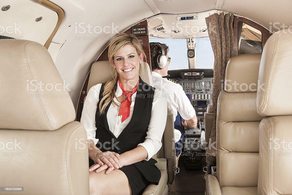 Flight Stewardess in Private Jet stock photo