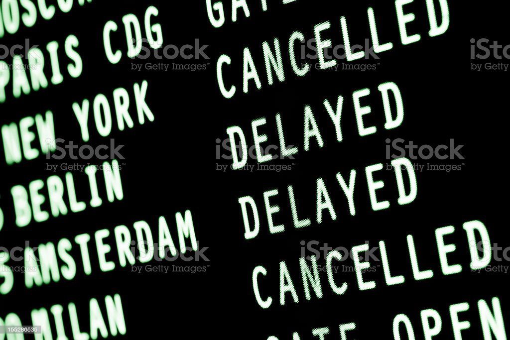 flights cancelled & delayed - airport arrivals departures information screen stock photo