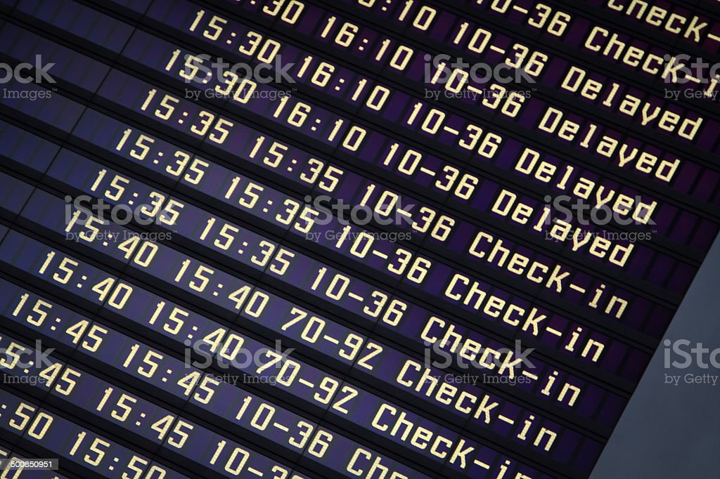 Flights information board in airport terminal stock photo