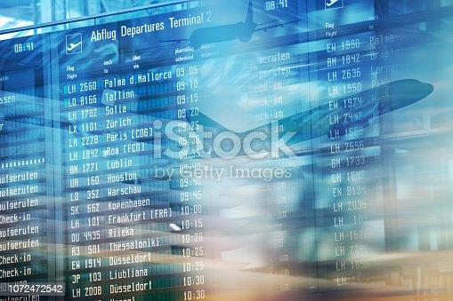 istock Flights information departures board in airport terminal. 1072472542