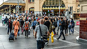 Melbourne, Victoria, Australia, March 15th 2019: Pedestrians are crossing the intersection of Flinders Street and Swanston Street in front of the Flinders street station.