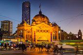 Flinders Street Station in Melbourne, Australia at dusk.