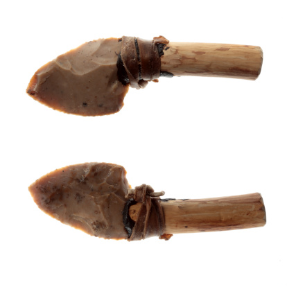 A flint blade mounted on wooden handle  bound with leather. Both sides view.