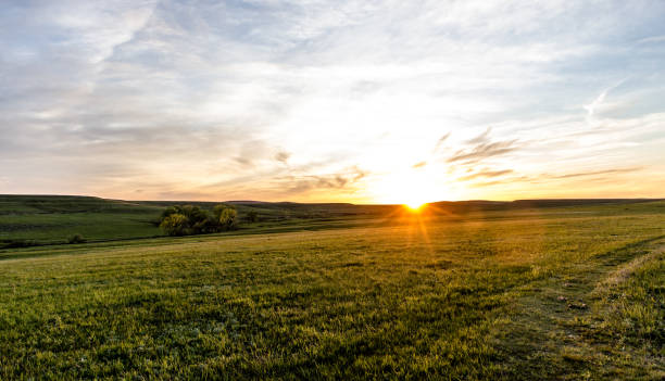 Flint Hills Sunset Sunset over the rolling Flint Hills of Kansas ranch stock pictures, royalty-free photos & images