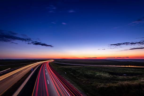 Flint Hills traffic Turnpike at dusk in the flint hills of Kansas multiple lane highway stock pictures, royalty-free photos & images