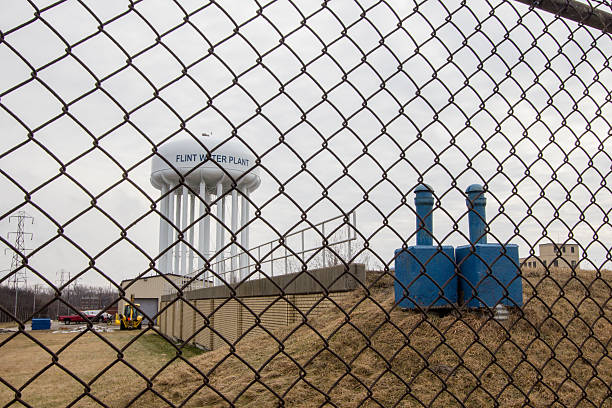 Flint Michigan Water Tower Through Chain Link Fence stock photo