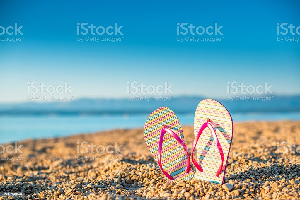 Flip flop at the seaside stock photo
