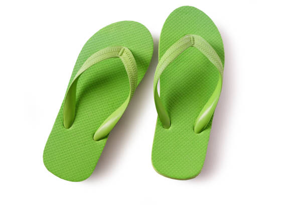 Flip flop beach shoes green isolated on white background stock photo