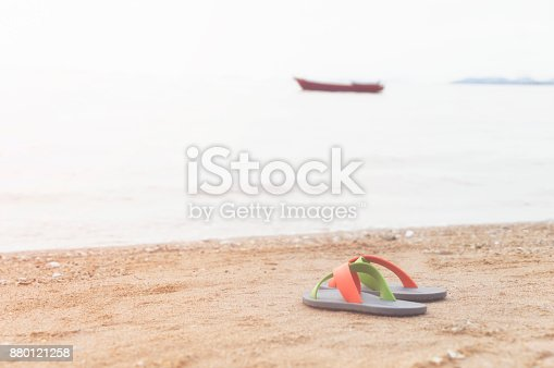 istock Flip flop on the beach, select focus 880121258