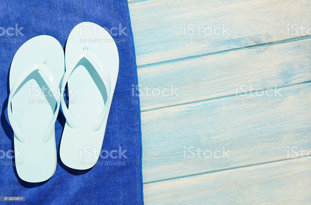 flip flops and towel on table stock photo