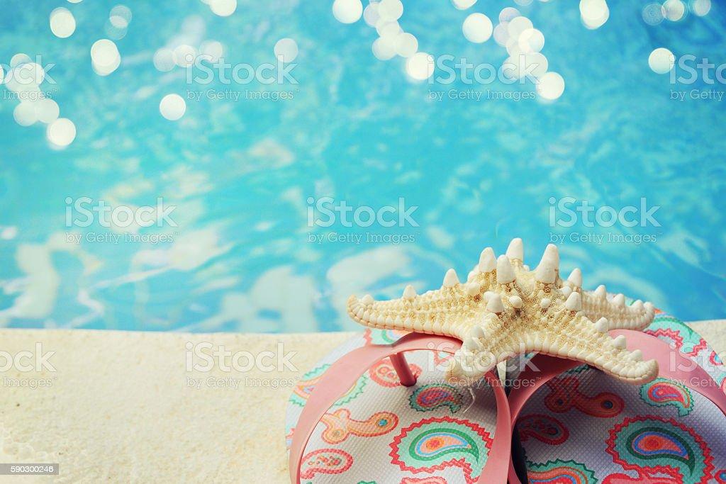 flip flops by the swimming pool royaltyfri bildbanksbilder