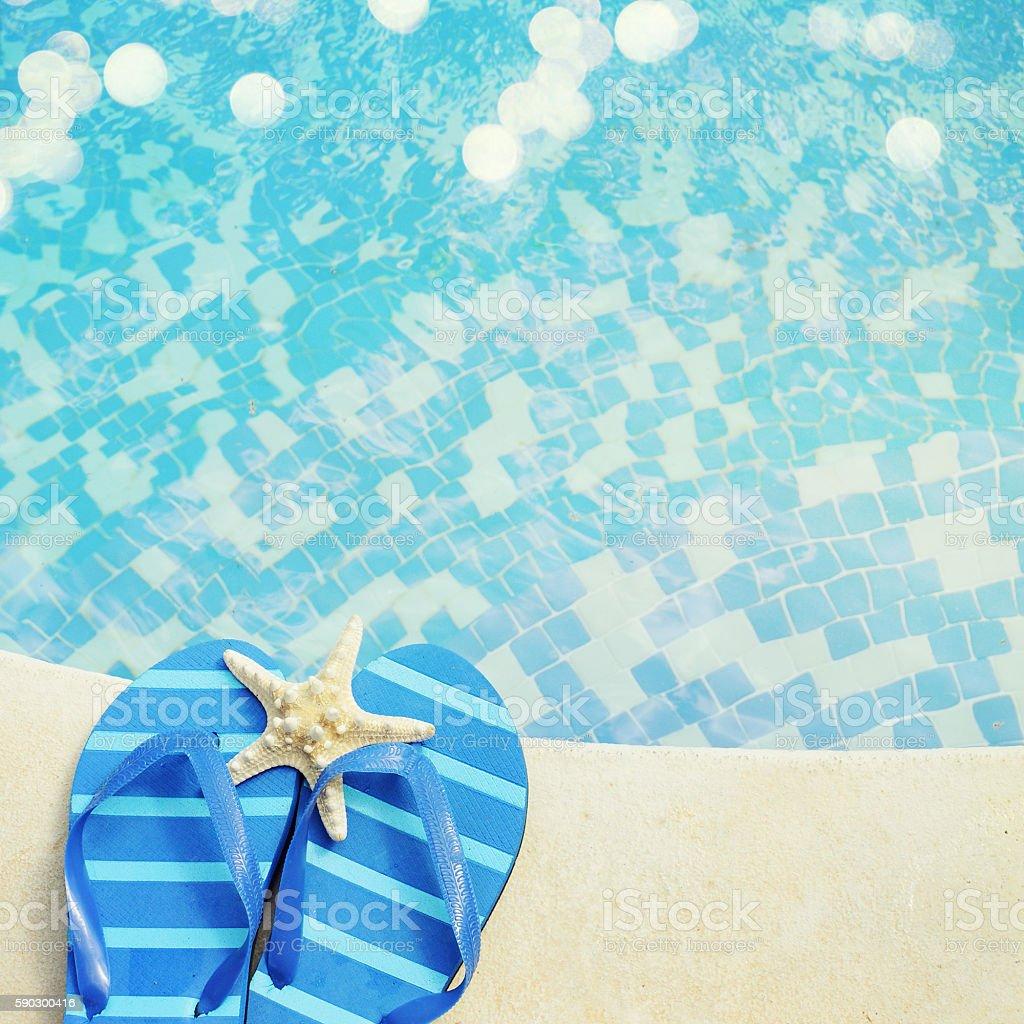flip flops by the swimming pool Стоковые фото Стоковая фотография